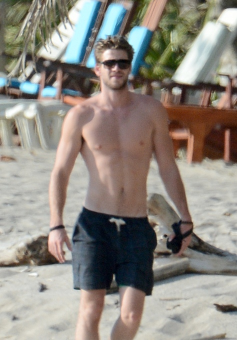 Exclusive - Hunger Games Hunk Liam Hemsworth Shows Off His Beach Body After Surfing